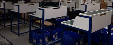 Repair benches with conveyors - Antistatic PVC worktops and electrical sockets