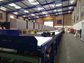 Gravity conveyor assembly line