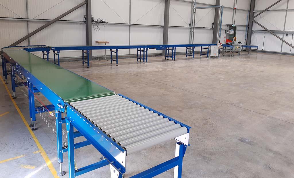 belt and gravity roller conveyor system